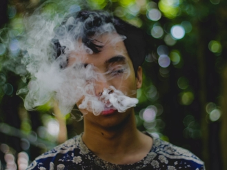 person exhaling smoke