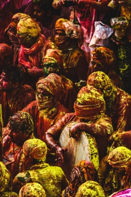 people wearing headscarf celebrating holi festival